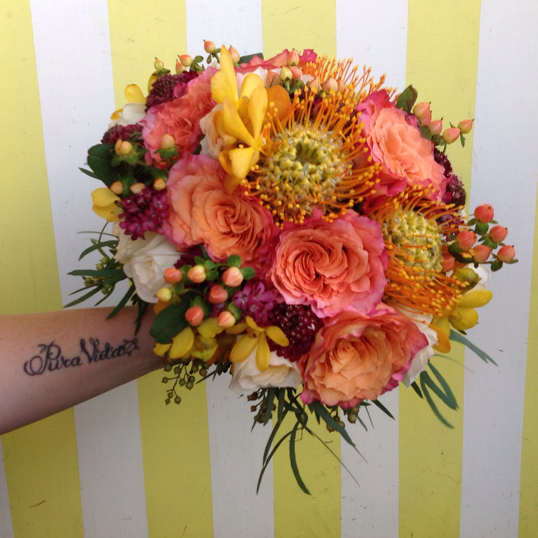 Classic Nosegay Style Bouquet Protea. Rose and Hypericum Berries