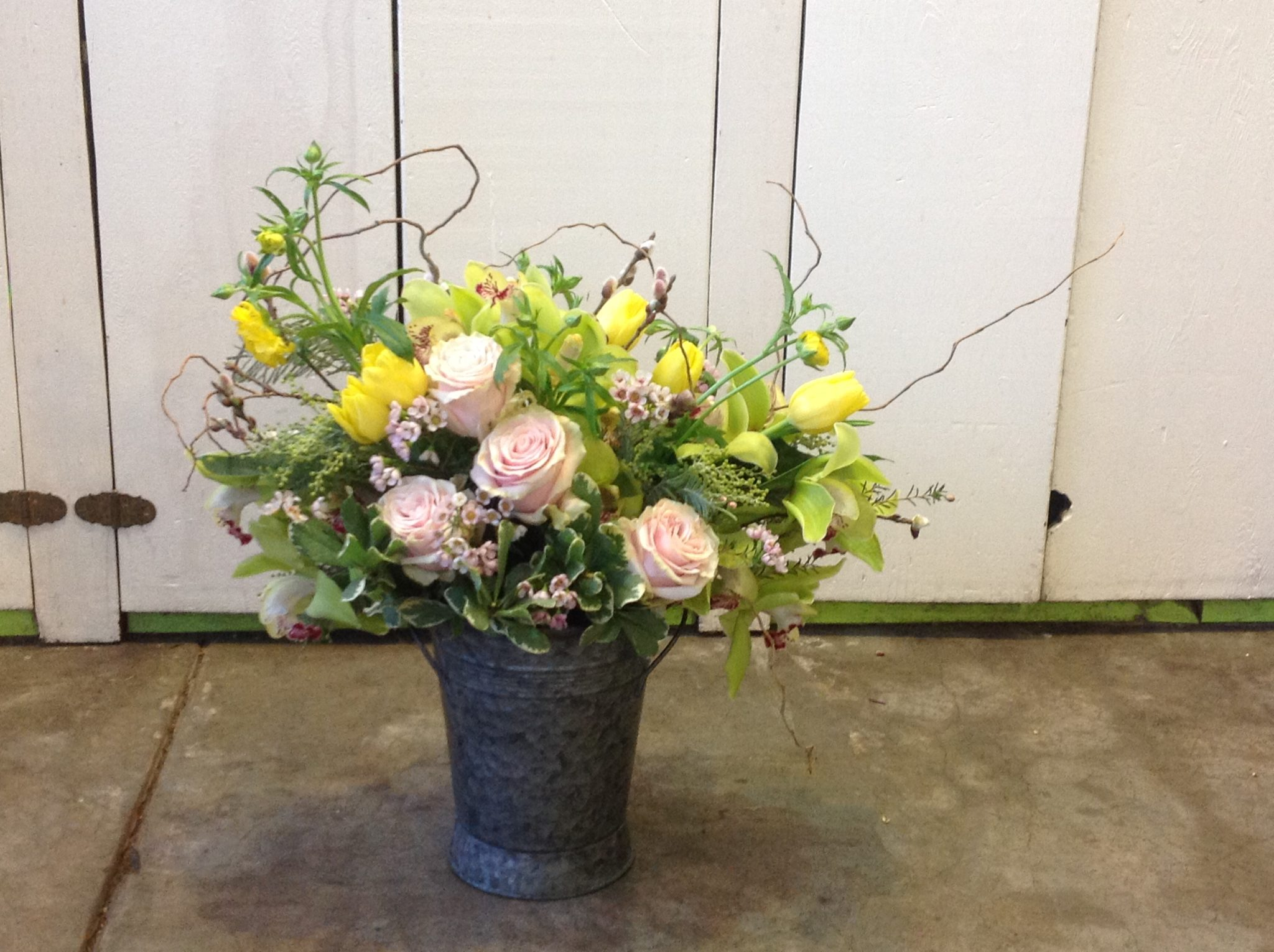 french flower bucket cymbidiums and roses