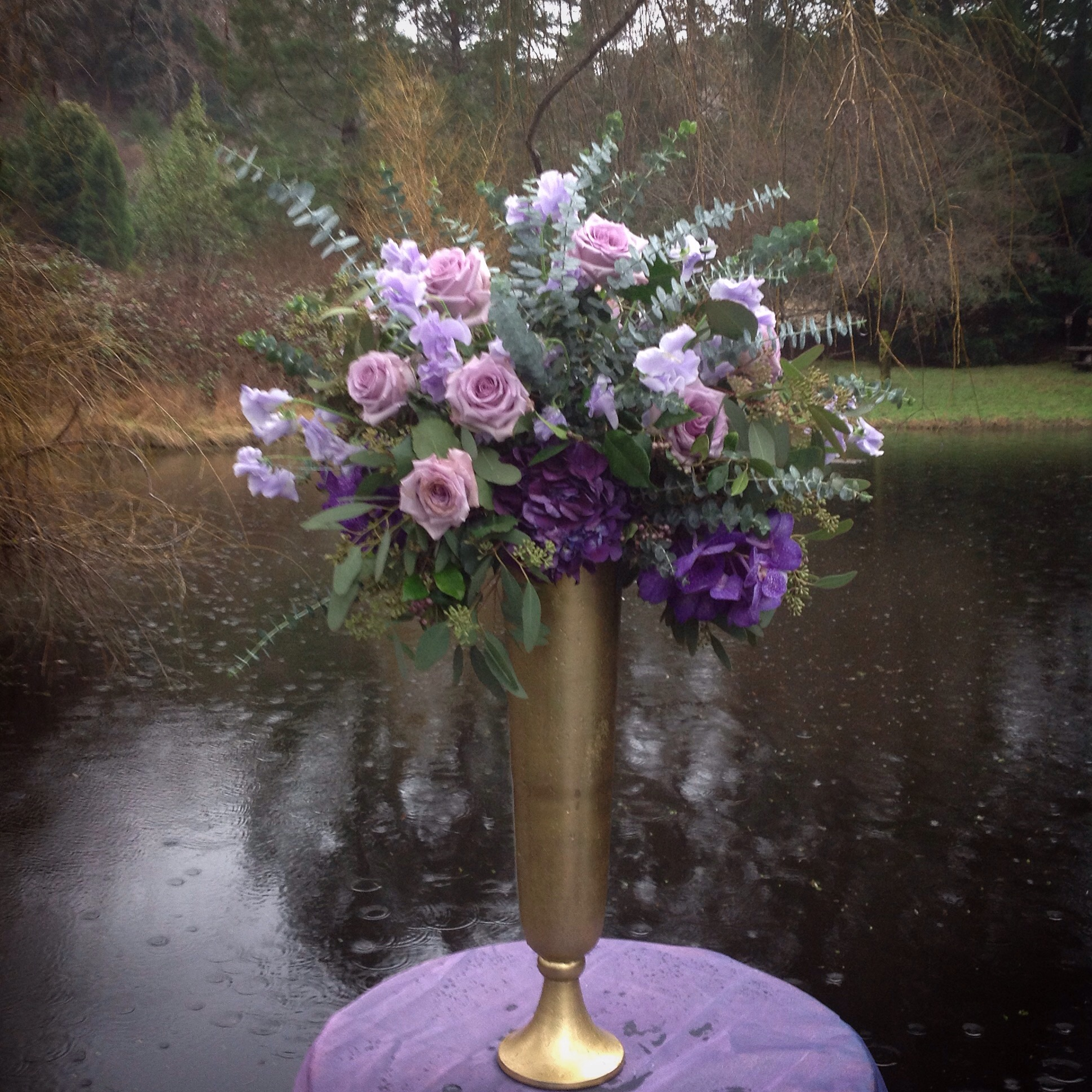 Large footed vase with Orchids and Roses