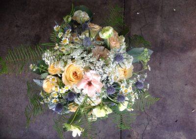 Wildflowers and texture galore in this Nosegay style bouquet.