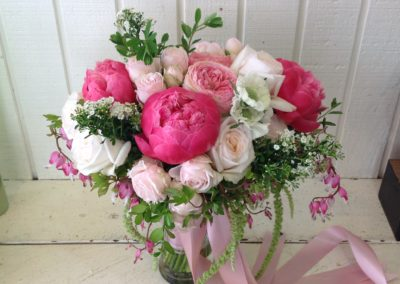 Lush Classic Nosegay Style Bride Bouquet with fragrant Roses and Bright Pink Peonies