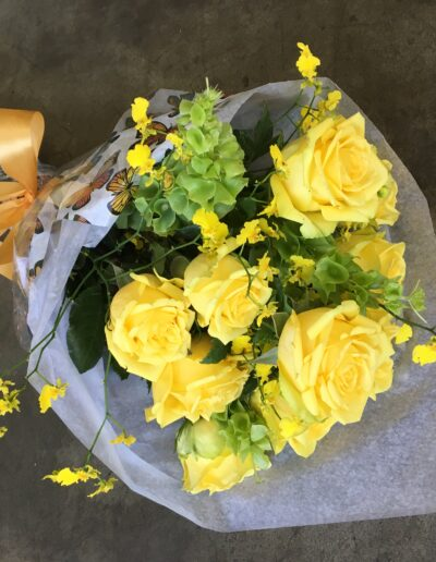 Hand tied bouquet with yellow roses